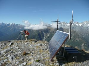 A GNS Science technician services a solar-powered GPS monitoring station at Gunn Ridge in Fiordland National Park. The instrument is one of  about 600 in the GeoNet nationwide network of instruments. Photo: GNS Science