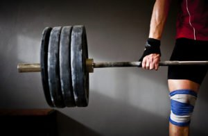 Man practising weightlifting III