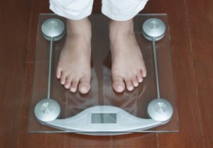 Woman Standing on Digital Weighing Apparatus